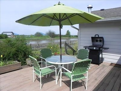 Enjoy outdoor cooking and dining overlooking the garden and slough.
