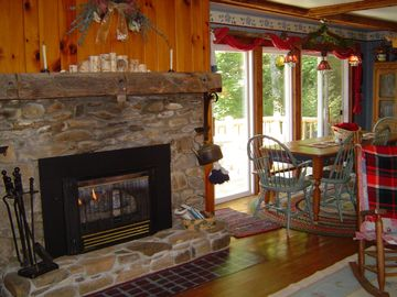 gaslog fireplace -dining table over looks the hardwoods, mountains and forest!
