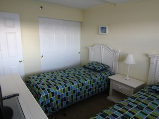 Vacation Homes in Ocean City condo photo - Bedroom 3 with 2 single beds and HD TV on dresser