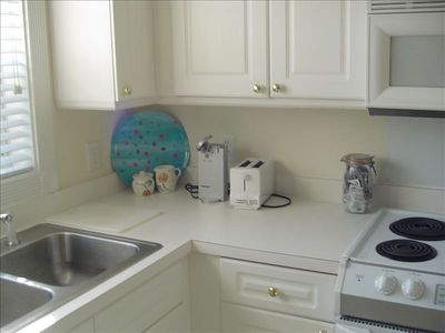 bright kitchen with all appliances and utilities