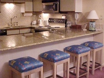 View of kitchen and breakfast bar. The Kitchen is fully equipped..........