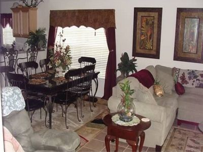 Living room, large sectional couch, wood/iron dining room seats 6, recliner