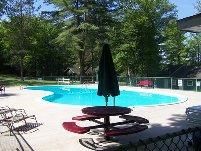 Outdoor heated swimming pool located walking distance from cottage.