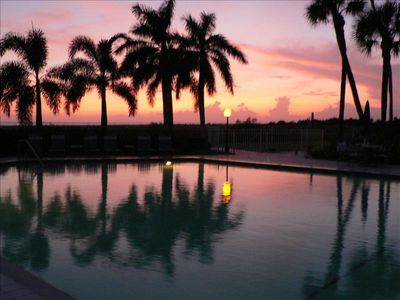 Sunset over swimming pool.