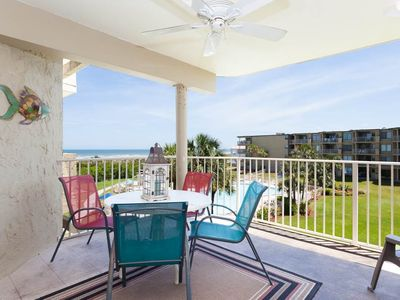 Enjoy panoramic views of the ocean from our spacious balcony. - Our covered balcony is the perfect place to sip your morning coffee while watching the sun rise over St. Augustine Beach!
