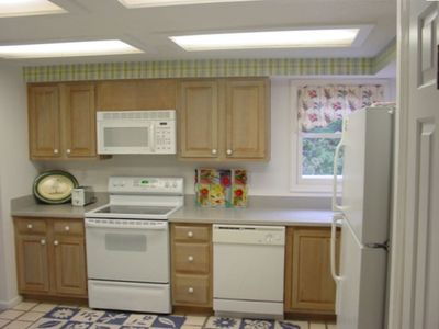 Spacious kitchen is well stocked with pots, pans and appliances.