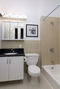 Full bathroom with tub, shower and medicine cabinet