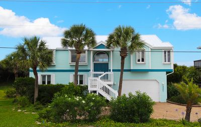 WaterColors front exterior; new blue paint & metal roof; ocean directly behind!
