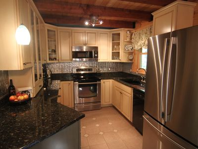 Chef's kitchen with granite, stainless luxury appliances & custom cabinets