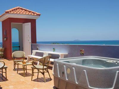 Private terrace with Jacuzzi, BBQ, Lounge Chairs..
