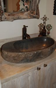 cool sink carved from a river rock