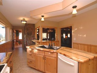 Estes Park lodge photo - Kitchen Leading into Dining Area and View Porch
