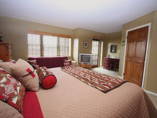 Lake Placid condo photo - Mastre Bedroom with Door to Lakeside patio and Beach.