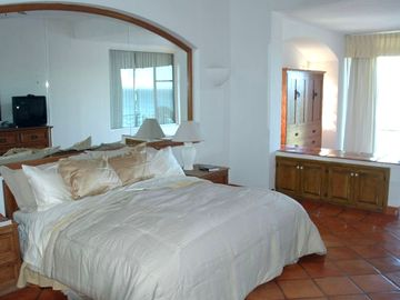 King Bed-Murphy bed in background-Door opens to balcony with ocean view