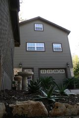 The apartment above the garage. The double window is the studio's kitchen. - Austin studio vacation rental photo
