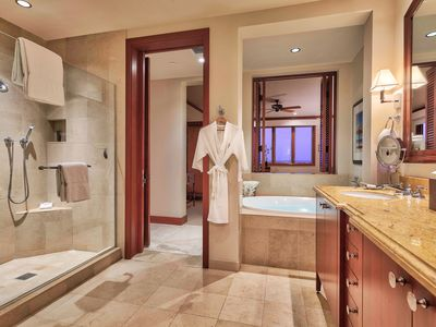 Spacious master bathroom with dual vanities, large soaking tub, separate shower.