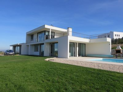 A luxury designer villa with private heated pool and stunning countryside views.