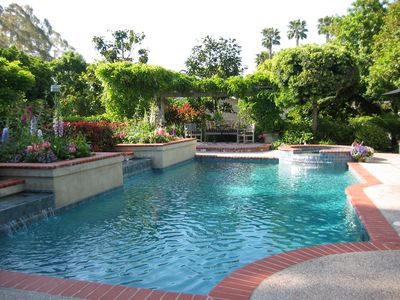 The 35 foot, dark bottomed pool and raised, wisteria shaded sitting area beyond