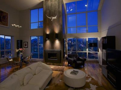 Dramatic airy light filled entertainment area with a soaring 18FT ceiling.