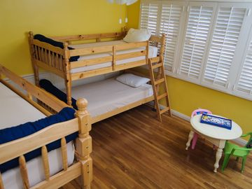 2 sets of twin bunk beds & plenty of floor space to play in this spacious room.