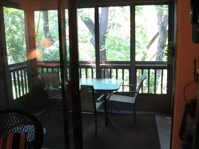 Enjoy your morning coffee from the screened in deck w/ view of the lake.