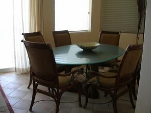 San Jose del Cabo condo rental - Dining Room with table and 6 chairs looks over the grounds and the ocean.
