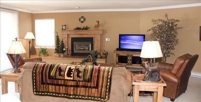 Living room has gas firplace, flat-screen HDTV, Sony PS3/Blu-Ray/DVD player