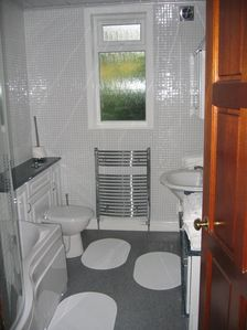 Family bathroom, with shower over bath