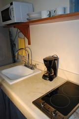 Isla Mujeres apartment photo - Kitchen includes electric stove, microwave, coffe maker, full size fridge.