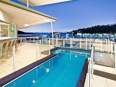 Night view of the harbour from your private pool