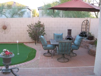 Back yard view - from dining area. Putting green and seating area.