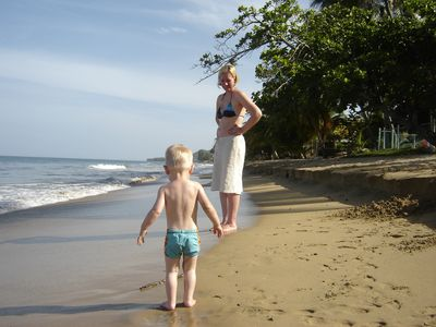 Mother and Son Walking on our Beach