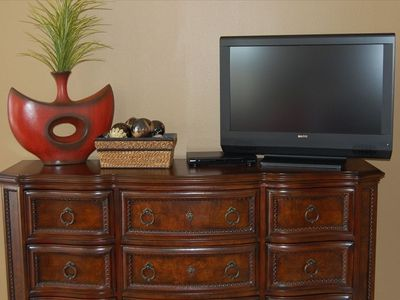 "Master Bedroom offers 32"" large screen LCD HDTV!"