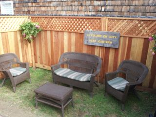 Morro Bay cottage photo - A comfortable back yard to relax and BBQ.