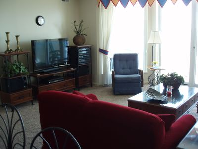Living Room With Balcony Access TV DVD VCR and Stereo
