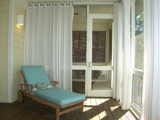 Port St. Joe house photo - Ahhhh, relax in the shade. Porch living in style!