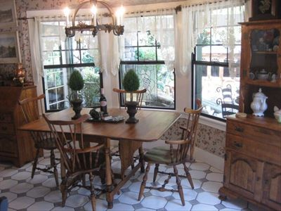 Kitchen Dinette in bay window looking out to old english garden