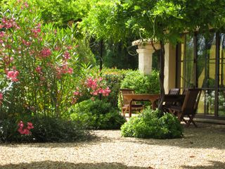 rear garden dining - Gordes farmhouse vacation rental photo