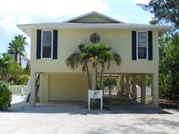 Beautiful elevated 3 bed pool home only 2 blocks to beach