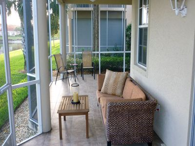 Lanai, tiled, comfortable seating plus dining table/chairs for outdoor dining.