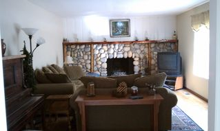 Living Room with oversized river rock fireplace - Lake Arrowhead cabin vacation rental photo
