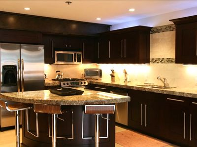 Fully equipped kitchen with slab granite and custom cabinets, all stainless