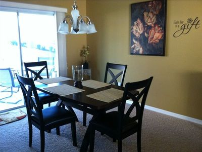 Comfortable Dining Room with views of the backyard or through the front window