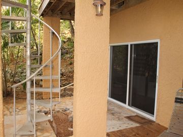 Entrance to lower level bedroom via spiral staircase from upper deck.
