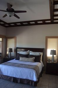 Master Bedroom- 16 foot ceilings & central air and flat screen television
