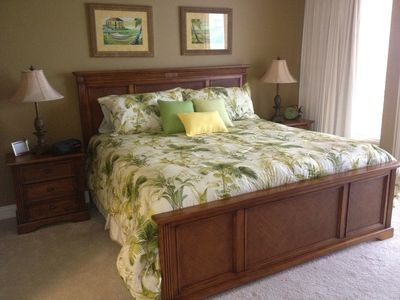 All new bedding on king size bed in master bedroom