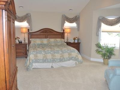 3rd Floor Master Bedroom with fireplace, wet bar, walk-in closet and balcony.