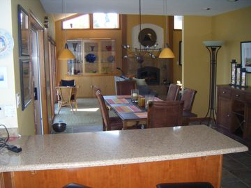 Kitchen opens up to dining room, and dining room to living room. Very open.