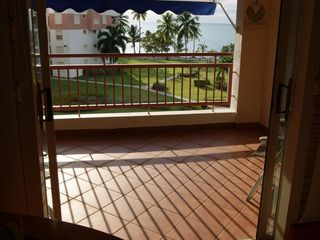 Cabo Rojo apartment photo - Balcony view from living room. As you may see, beach is right there.