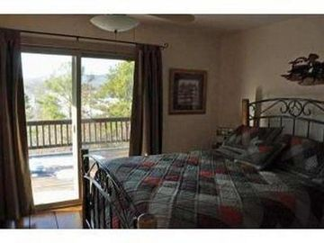 Master bedroom off the deck. Great for morning coffee